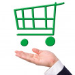Conceptual image, green shopping cart on hand. — Stock Photo #17651609