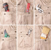 Collection of tools in trousers — Stock Photo