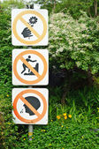 No climbing, no spitting, no deflower signs — Stock Photo