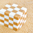 Cube of brown and white sugar cubes - Stock Photo