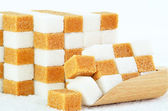 Piles of brown and white sugar cubes — Stock Photo