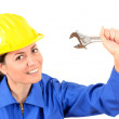 Female builder with helmet and big wrench — Stock Photo #23800423