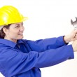 Female builder with helmet and big wrench — Stock Photo
