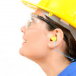 Woman with protective equipment and ear plugs — Stock Photo #23800455