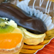 Different cakes and eclair — Stock Photo