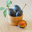 Half of a purple plum on the wooden table — Stock Photo