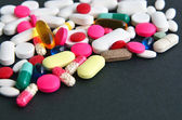 Assorted colored pills and capsules — Stock Photo