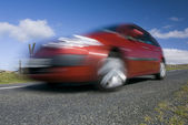 Blurred red car — Stock Photo