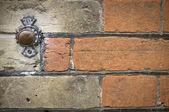 Door bell button on brick wall — Stock Photo