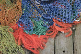 Fishing nets on the old wooden pier — Stock Photo