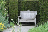 Garden bench in English garden — Stock Photo
