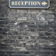 Stock Photo: Receptions sign on brick wall