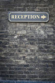 Receptions sign on brick wall — Stock Photo