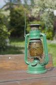 Vintage kerosena lamp in garden — Stock Photo