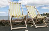 Deckchairs on pier in Paignton Devon UK — Stock Photo