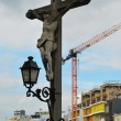 Stock Photo: Crucifixion on background of modern city