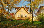 House in the autumn forest — Stock Photo
