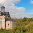 The old church on the background of the autumn forest - Stock Photo