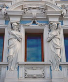Window with statues — Stock Photo