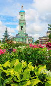 Bell tower and flowers — Stock Photo