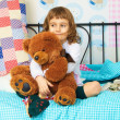Little girl with bear cub — Stock Photo
