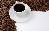 Coffee cup and coffee baens — Stock Photo