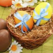 Colorful easter eggs in the basket — Stock Photo #16067069