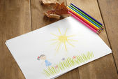 Kid's picture on the wooden table — Stockfoto