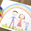 Kids drawing happy family — Stock Photo