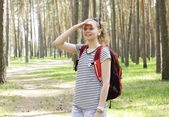 Beautiful girl is hiking at the forest — Stock Photo