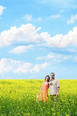 Happy man and woman in yellow meadow — Stok fotoğraf