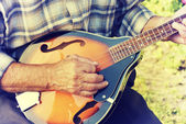 Senior man playing mandolin — Stock Photo