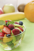 Sweet tasty fruit salad in the bowl — Stock Photo