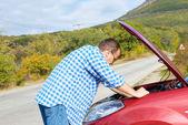 Adult man is standing near his broken car — Stock Photo