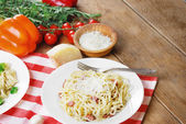 Pasta carbonara on the wooden table — Stockfoto