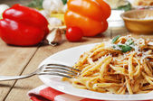 Pasta bolognese on the wooden table — Stock Photo