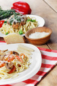 Pasta with shrimps and mashrooms on the wooden table — Stok fotoğraf