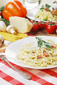 Pasta carbonara on the wooden table — Stock Photo