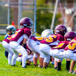 Kids Football Players in Line of Scrimmage - Stock Photo