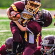 Youth football player tackles another — Stock Photo #13378140