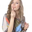 Royalty-Free Stock Photo: Applying lipstick using lip concealer brush