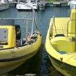Stok fotoğraf: Boats in harbour in Portugal. Point of cameris from Pier.