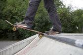 Skateboard with Skateboardshoes — Stock Photo