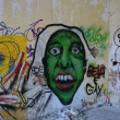 Green monster face graffiti — Stock Photo