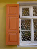 Orange blinds on a window — Stock Photo