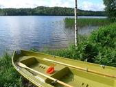 Lakeside boat — Stock Photo