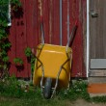 Yellow wheelbarrow — Stock Photo
