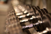 Rack of dumbell weights — Stock Photo