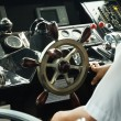 Stock Photo: Skipper piloting boat in control room