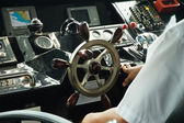 Skipper piloting a boat in control room — Stock Photo